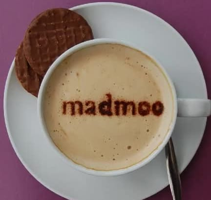 write a short message in the froth of a cup of cappuccino coffee, NOT photoshop