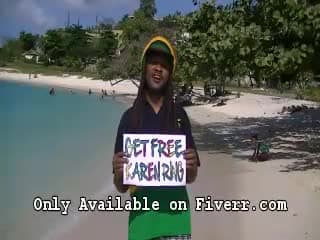 hold a sign dressed as a Rastafarian on a Jamaican Beach