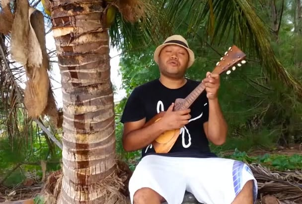 sing a personalized mothers day song with my ukulele at the beach