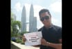hold your sign in front TWINTOWER Kuala Lumpur