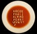 write a message in alphabetti spaghetti on a plate or toast or bowl