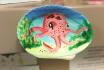 paint an ocean scene on three seashells