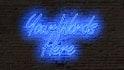 create a custom neon sign on a brick wall