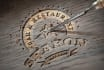 emboss your logo on a realistic wood surface