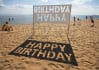 display your message with sunlight on beach sand